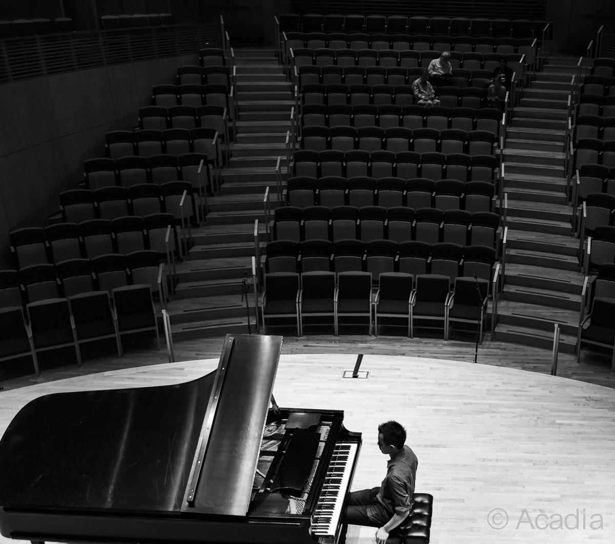Piano artist in an empty concert hall