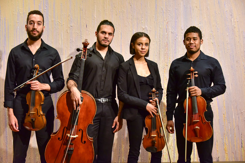 Ivalas String Quartet posing at the Portland Museum of Art