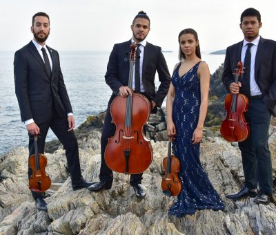 Ivalas string quartet posing by the ocean