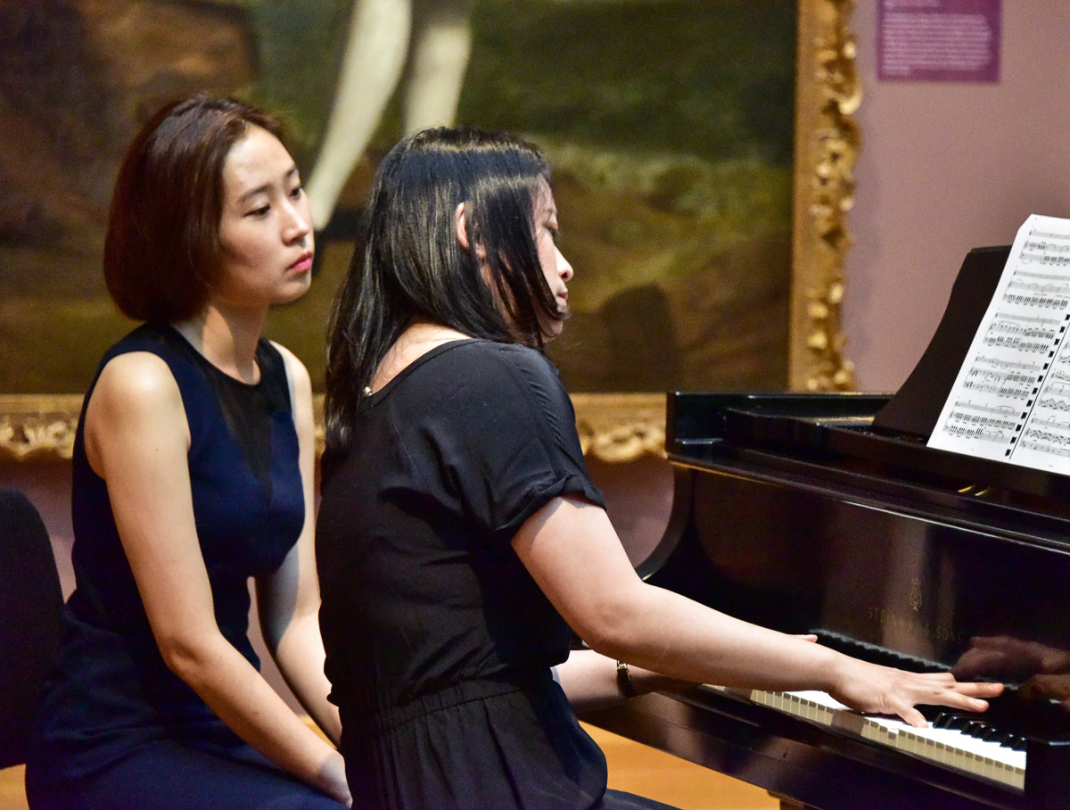 Collaborative piano artists performing Music at the Museum