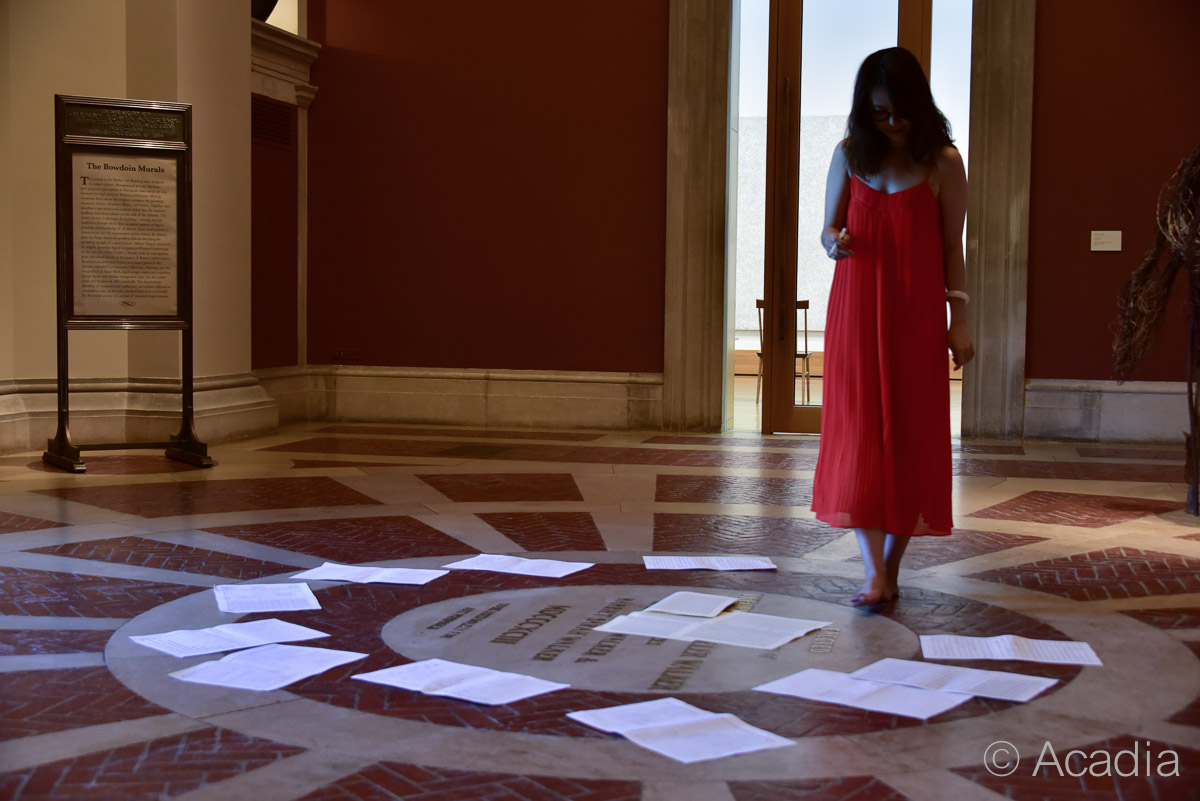 Woman looking at music sheets scattered on the ground