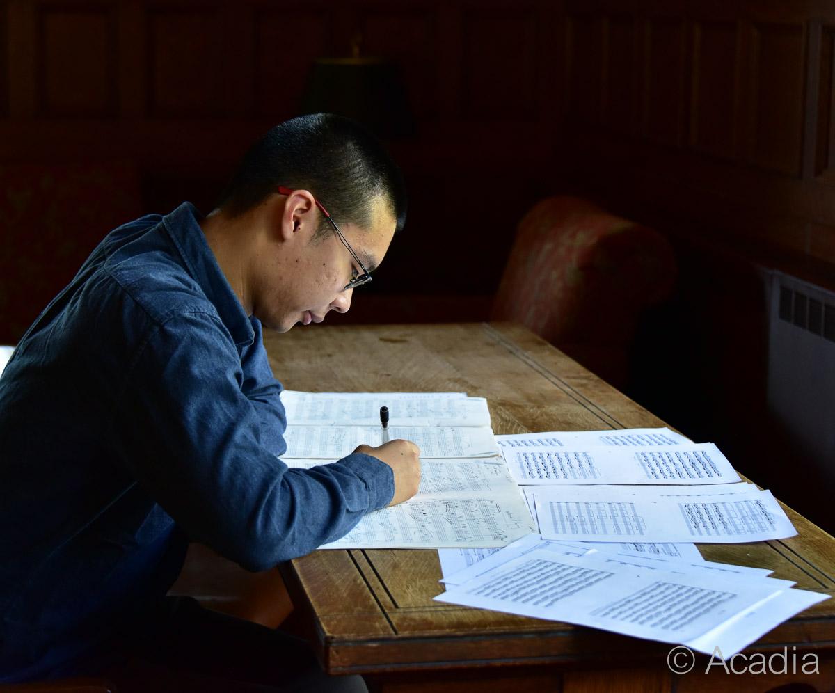Composer Sam Wu writing music