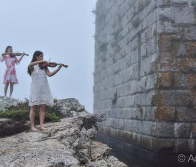 String players standing by the cliffside