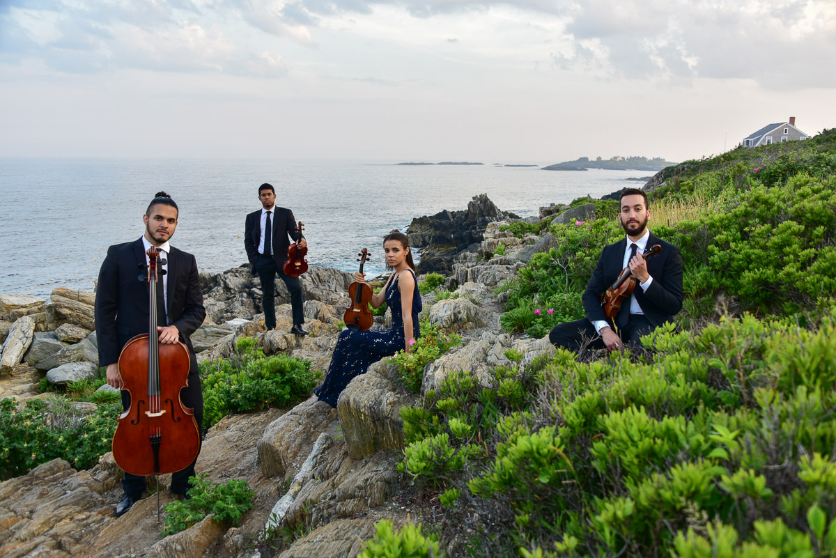 The Ivalas Quartet posing by the ocean