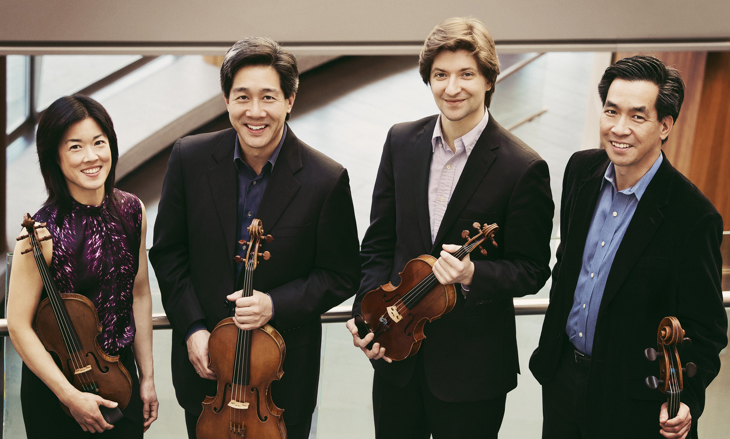 Ying Quartet, left to right: Janet Ying (violin), Phillip Ying (viola) new first violinist Robin Scott, and David Ying (cello), in Wolk Atrium outside Hatch Hall at Eastman Theatre, Eastman School of Music