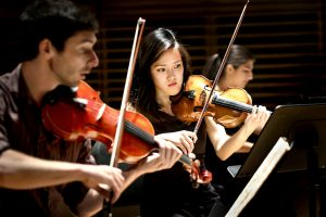 Young student artists performing at Studzinski Recital Hall
